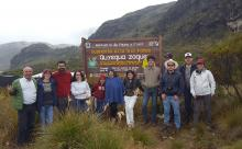 Group of people standing by a sign post in the Colombian Andes